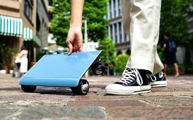 Стартап японской компании Cocoa Motors представил «автомобиль в сумке» (ВИДЕО)